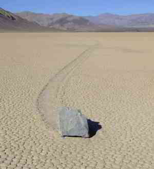 Cold nights and hot days cause layers of ice to form temporarily. They are moved by wind and push rocks called sailing stones along the ground of Death Valley.