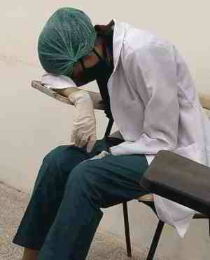 A doctor in Pakistan catching some sleep after an exhausting day taking care of Coronavirus patients